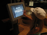 Hannah checking out info on country music in the Country Music Hall of Fame in Nashville TN 09042011