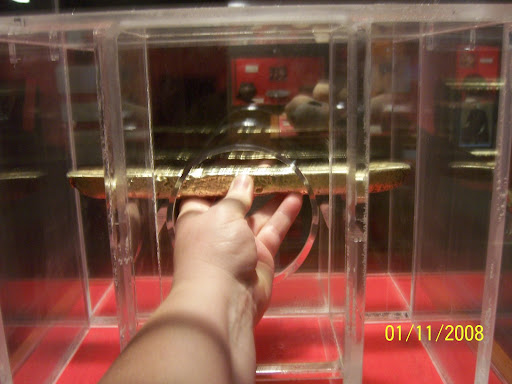 at Mel Fisher museum - holding gold bar recovered from a spanish galleon from 1600's or 1700's