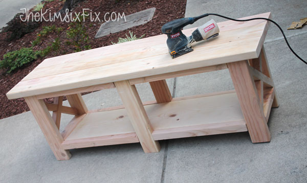 Sanding wooden bench