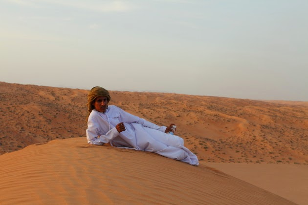 Omani man on the tall dunes of Wahiba Sands, Oman