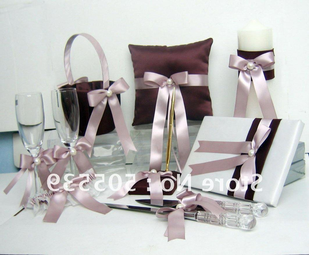 Wedding decoration includes: a guest book, a pen holder, a ring pillow,
