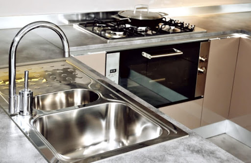 4 Steps & Tips on How to Clean a Kitchen Sink