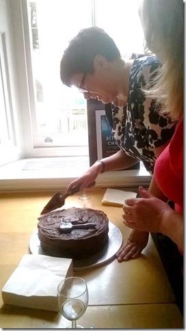 Sarah cuts cake 1