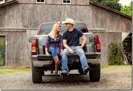 on-back-of-pickup-truck-smiling-at-each-other-cowboy-hat-on