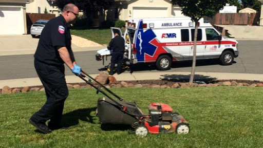 Elderly man passes out mowing lawn