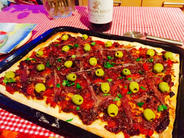 Pissaladiere - a Provencal pizza with onion, anchovies and olives
