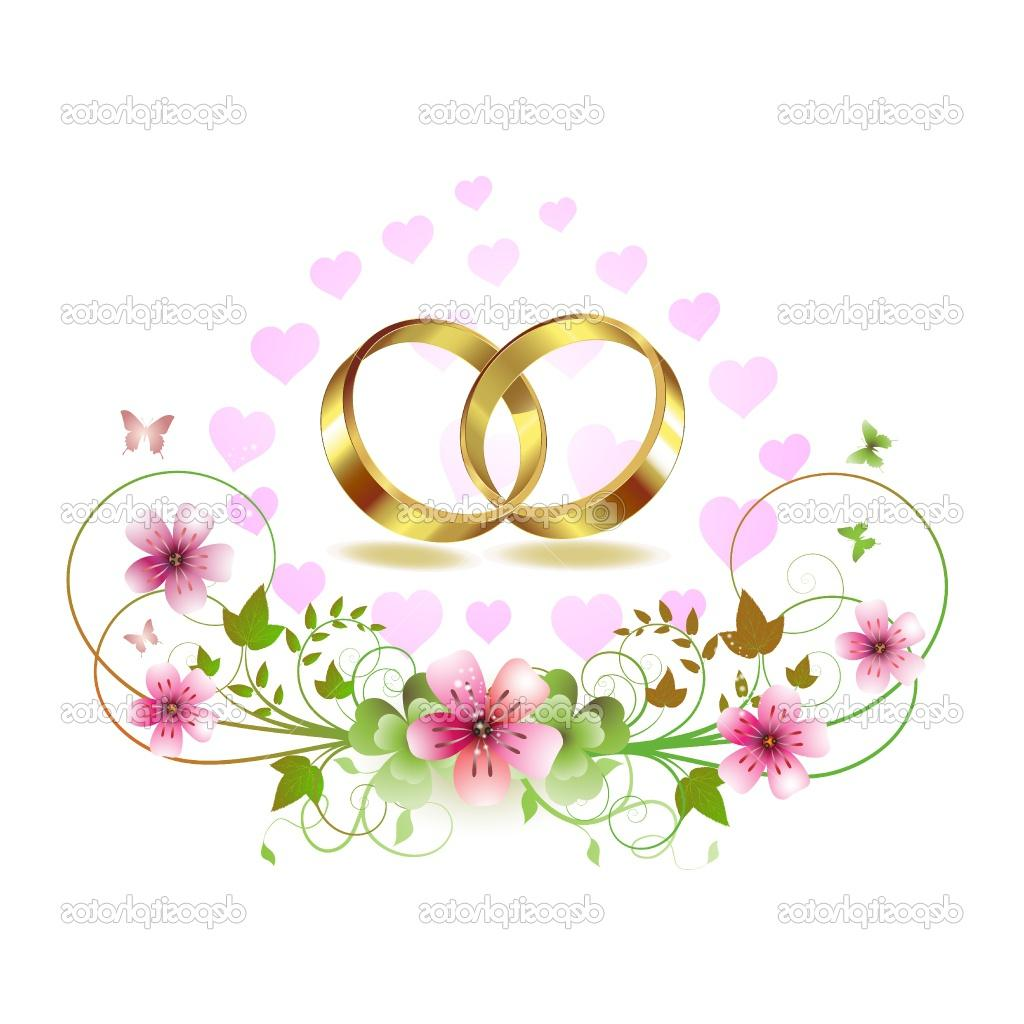 Two wedding ring with hearts and decorated flowers isolated on white