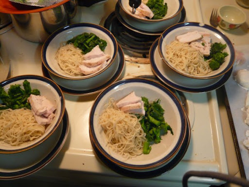 Chinese Egg Noodle Soup: chicken, Chinese broccoli, egg noodles awaiting broth, poached eggs and sriracha.