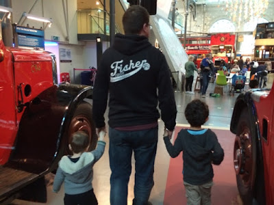Baby boy, Daddy and Big boy holding hands at the Transport Museum