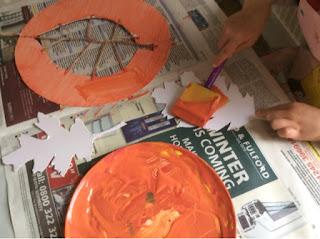 Sponge brush with orange paint