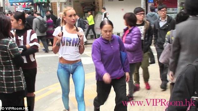 Watch: Model walks half naked around Hong Kong