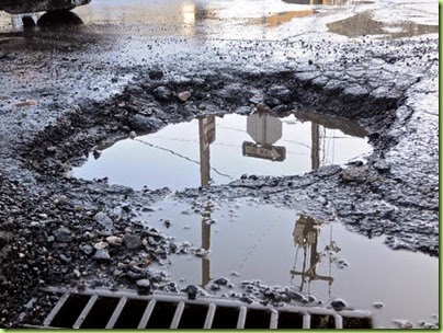 635657440683082309-AP-Potholes-PAPOE101