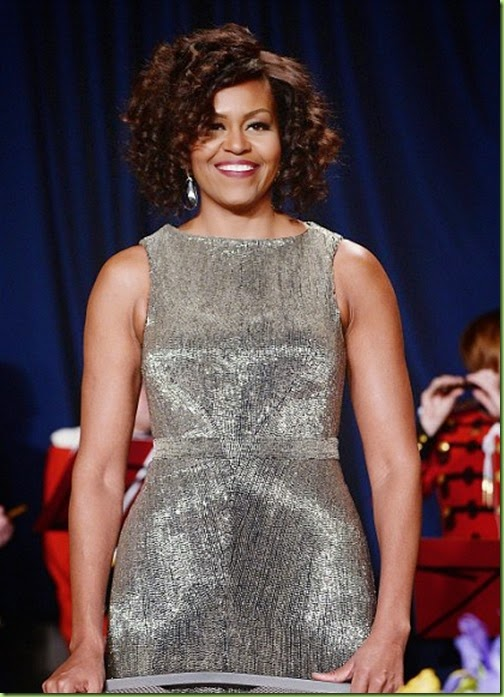 28010A9000000578-3055712-Mrs_Obama_s_curly_do_left_differed_from_the_straight_style_she_u-m-90_1430012426015