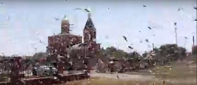 A swarm of locusts invades Achikulak, Russia, on 30 July 2015. Swarms of locusts in Southern Russia are the worst in more than 30 years. On state television, Russian news broadcasts link the plague to climate change, connecting the phenomenon to recent flooding amid higher than average temperatures. Photo: ViralHog / YouTube