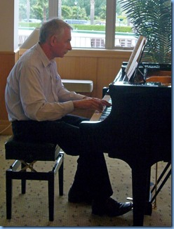 Claude Moffat playing the grand piano. Photo courtesy of Diane Lyons