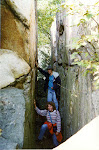 Tanja Vocke and I hiking through a crevice at Chimney Rock.