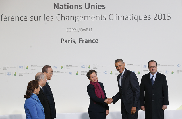 U.S. president Barack Obama shakes hand with Christiana Figueres, as Ban Ki-moon, and the French delegation including President Hollande, right, looks on, as delegates arrive for the COP21 talks in Le Bourget, Paris, 30 November 2015. Photo: Christophe Ena / AFP / Getty Images
