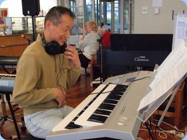 Takashi Iida playing his Yamaha Electone D-Deck two manual keyboard with pedalboard. Wonderful music culminating in playing Chopin's Fantasie Impomptu. Photo courtesy of Dennis Lyons.