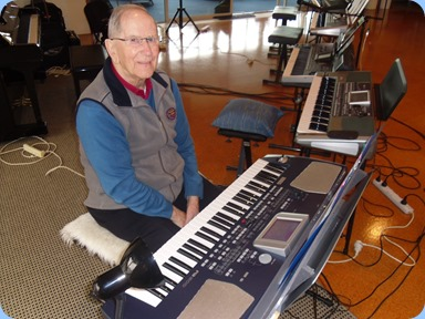 John Beales playing his Korg Pa500. Photo courtesy of Delyse Whorwood.