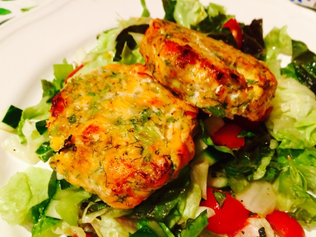 Healthy salmon burgers and salad