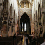 Dr. Loos points out the Gothic arcade inside the cathedral at Ulm