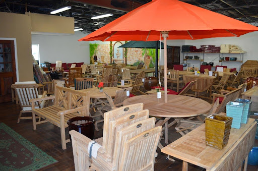 Bright accents like umbrellas and #pottery will turn your #outdoor space into a beautiful area to relax and gather. #home #outdoor #decorating #teak #furniture #patio #pool