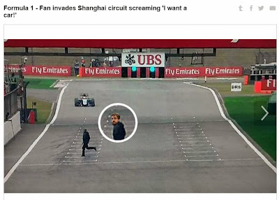 болельщик выбегает на трассу на Гран-при Китая 2015