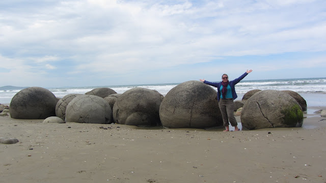 Heather with the oddly spherical Moeraki Boulders.