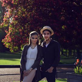 Teenage couple in Kensington Gardens, London. by Turhan Koray - People Couples ( love, kensington gardens, england, park, hyde park, london, sunny, couple )