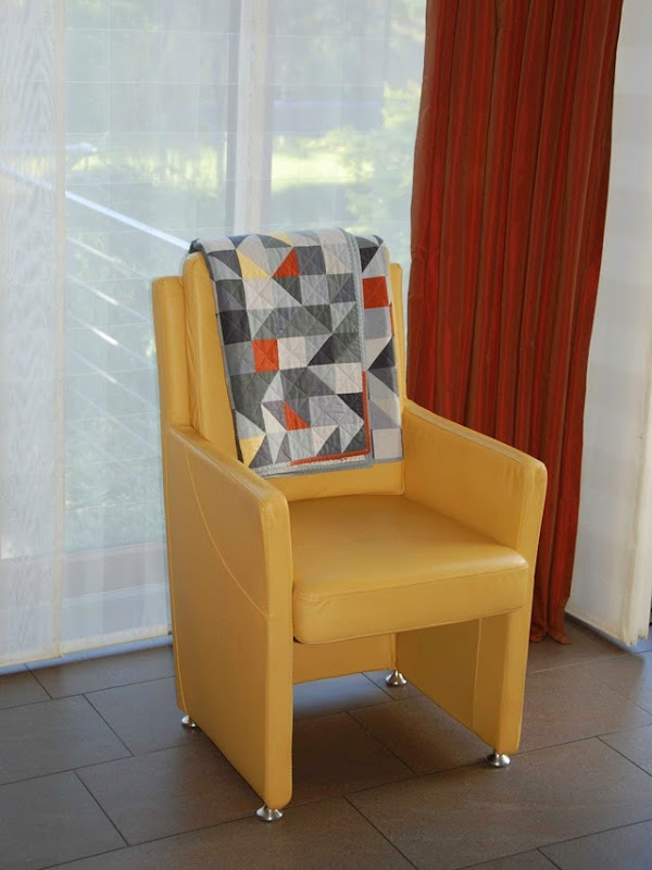 Quilt on the yellow chair