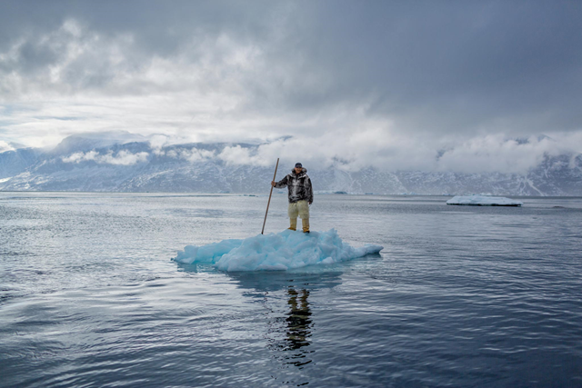 Albert Lukassen's world is melting around him. When the 64-year-old Inuit man was young, he could hunt by dogsled on the frozen Uummannaq Fjord, on Greenland's west coast, until June. This photo shows him there in April 2015. All the photographs for this story were taken on the fjord. Photo: Ciril Jazbec / National Geographic