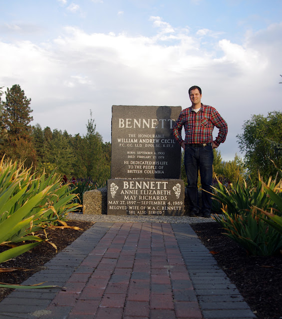 Standing next to W.A.C. Bennett's tombstone.
