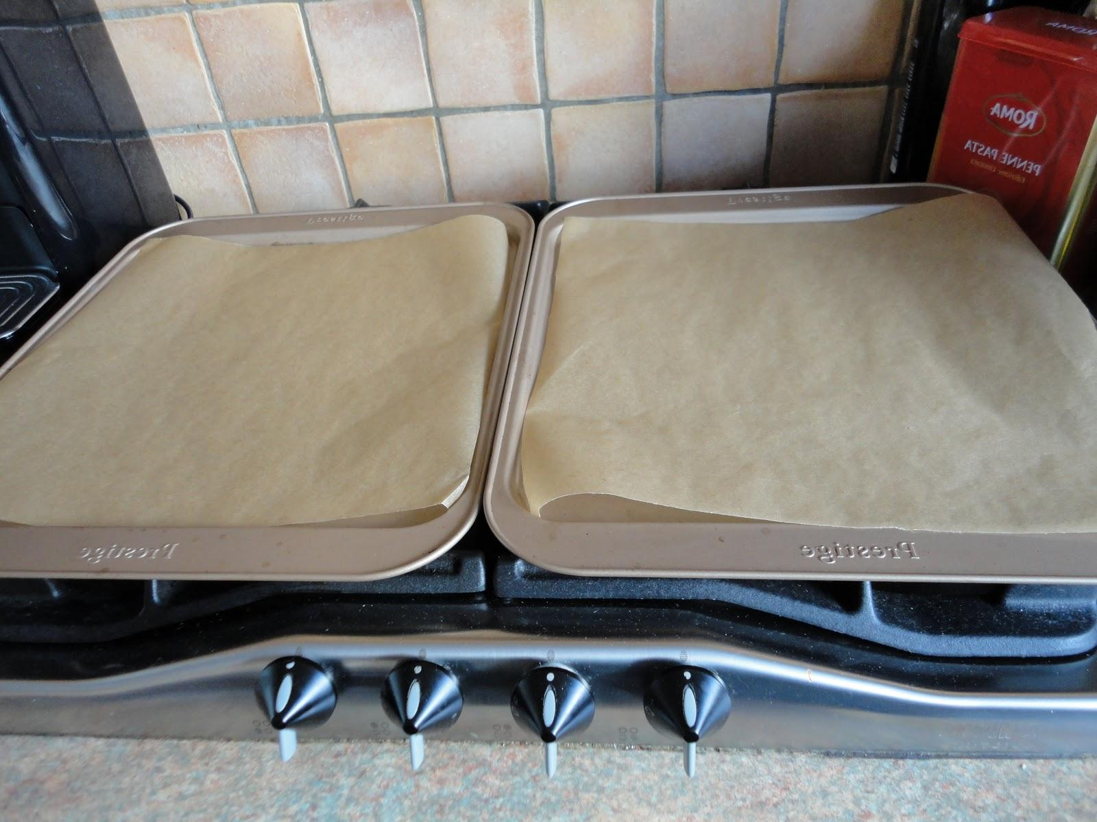 line two baking trays with