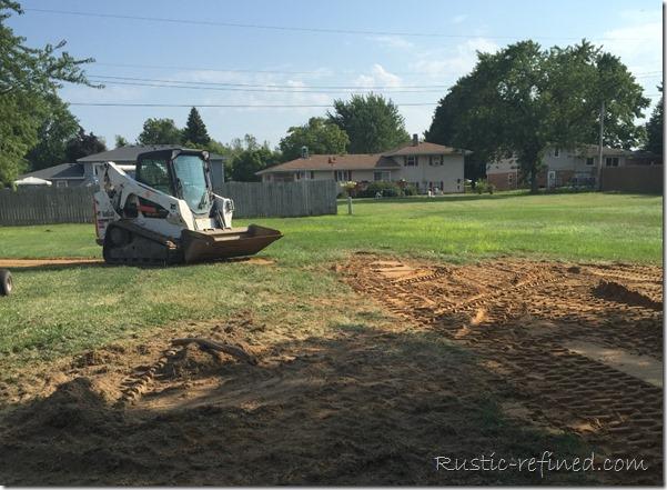 Bobcat re-grading the backyard