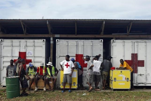 Days after Cyclone Pam, people wait to load up portable water purification units and supplies at a Red Cross aid centre in Port Vila, capital city of the Pacific island nation of Vanuatu, 19 March 2015. Photo: Edgar Su / Reuters