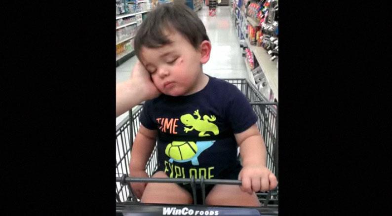 adorable-little-boy-sleeping-in-market-basket