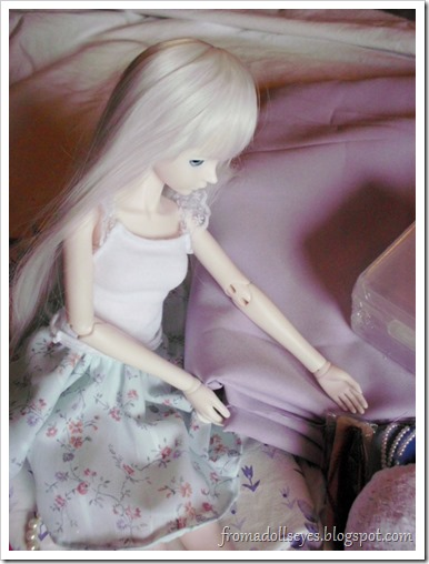 Ball Jointed Doll Admiring Purple Fabric