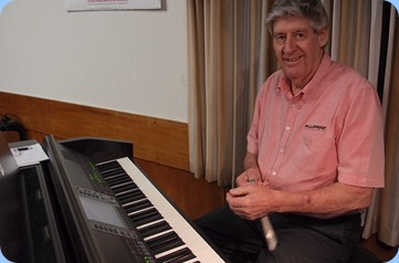 Ian Jackson preparing to play the Club's Clavinova CVP-509. Photo courtesy of Dennis Lyons.