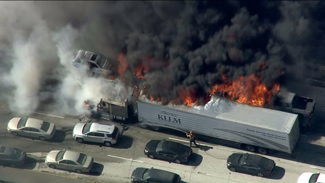 A big-rig burns on the 15 Freeway in the Cajon Pass as a brush fire that grew to more than 3,500 acres moves toward two mountain communities, 17 July 2015. Photo: KTLA