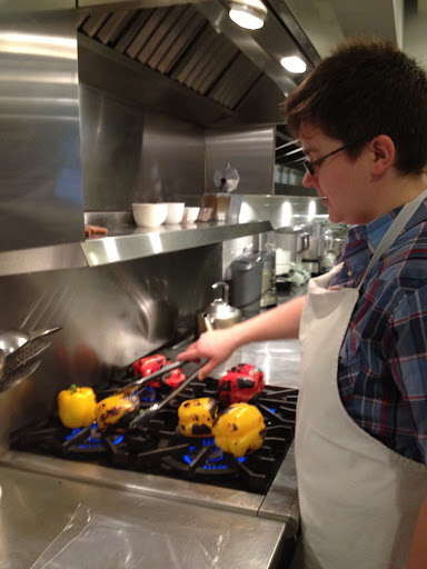 RD, my trusted shoot assistant, roasting the peppers