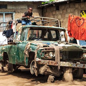 Multipurpose Junk by Tom Howes - Transportation Automobiles ( tanzania, people )
