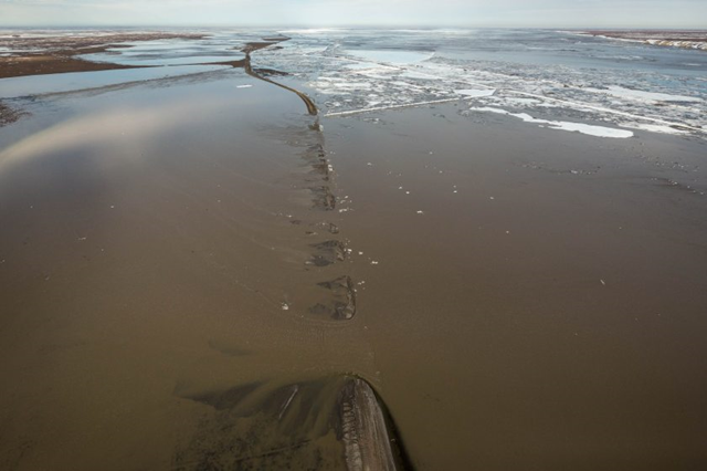 The Dalton Highway is washed out south of Deadhorse on Thursday, 21 May 2015. The nearby Sag River has overflowed the road, cutting off the main supply route for the Prudhoe Bay oil fields. Photo: Loren Holmes / ADN