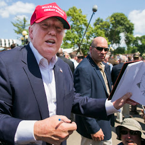 UNITED STATES - August 15: Republican presidential candidate Donald Trump laughs as he is asked to sign a sketch drawing of himself at the Iowa State Fair in Des Moines, Iowa, on Saturday, August 15, 2015. (Photo By Al Drago/CQ Roll Call)