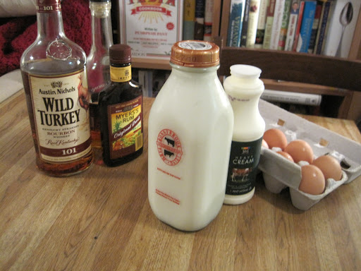 what you'll need: bourbon, dark rum, brandy, whole milk, heavy cream, egg yolks & sugar.