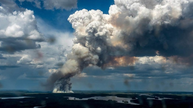 A massive plume of smoke rises from a wildfire in the LaRonge, Saskatchewan, area on 1 July 2015. There are 114 fires burning in northern Saskatchewan as of midday 4 July 2015. Photo: Saskatchewan Ministry of Environment / Wildfire Branch / Canadian Press