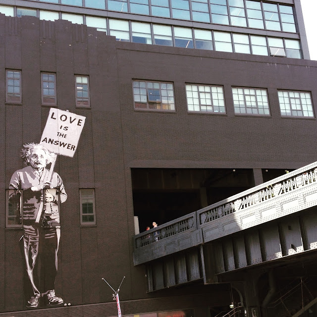"Banksy piece with Einstein holding ""Love is the answer"" sign at the High Line"