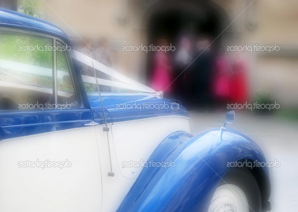 Wedding car waits outside of church during wedding ceremony