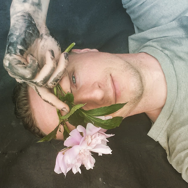 man Actor Paul Cram with flower