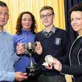 Denis McGinley, Sports Team Captain receives his trophy from Shaun McFadden, Tara Friel, Teacher and Fiona Temple, Principal at the Mulroy College Junior Prize Giving.   Photo:- Clive Wasson
