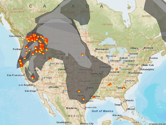 A screenshot of fire and smoke conditions in North America on 25 August 2015. Orange icons show fires and gray shading represents smoke. Graphic: AirNow